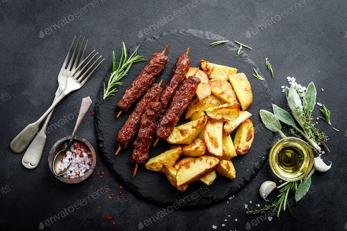 Grilled shish kebab with baked potato