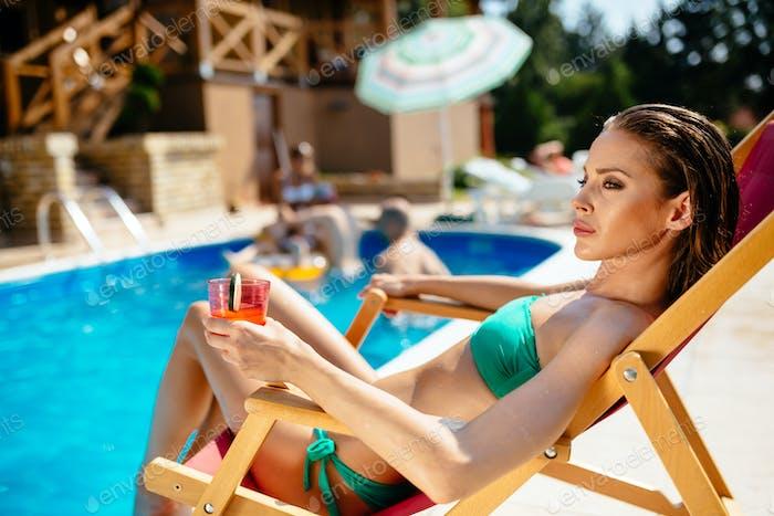 Glamorous woman tanning