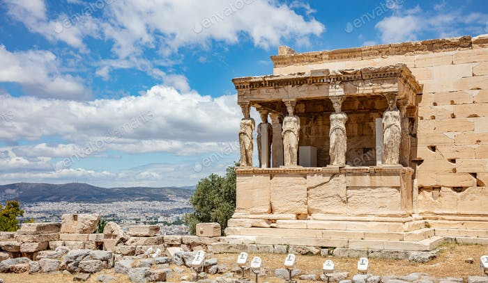 Athens, Greece. Erechtheion with Cariatides Porch on Acropolis hill, blue sky background