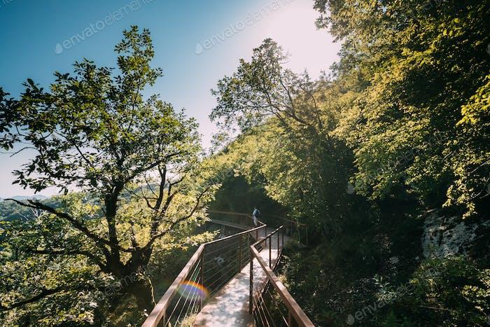 Zeda-gordi, Georgia. Man Walking On Narrow Suspension Bridge Or