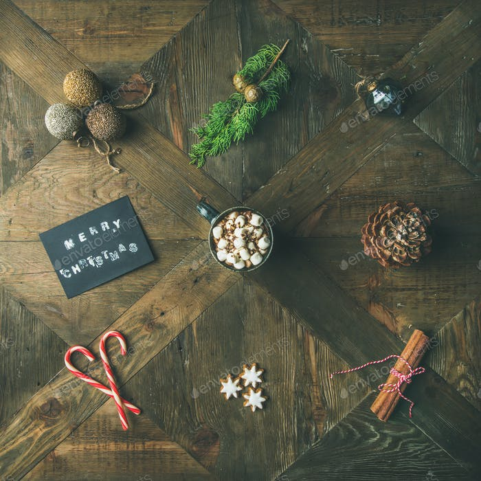 Flat-lay of greeting card, hot chocolate, candy cane, copy space