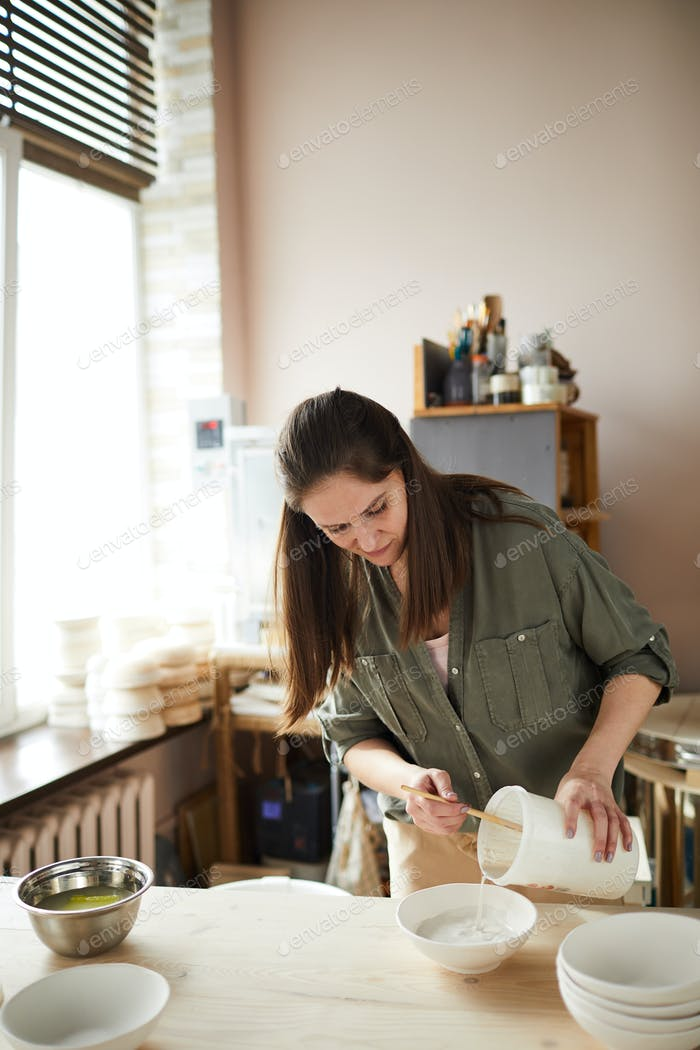Young Woman in Pottery Shop
