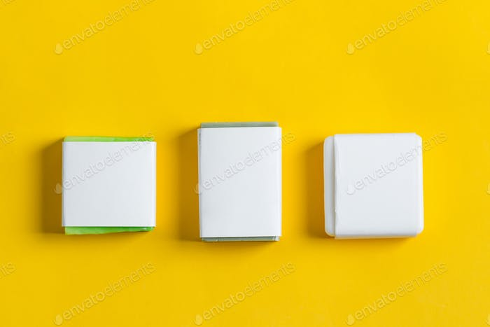 Handmade herbal natural soap bar set with paper label on a yellow background. Mock-up for your