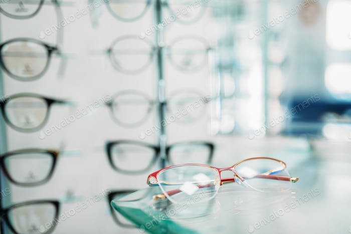 Glasses showcase in optic shop closeup, nobody
