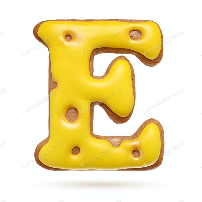 Capital letter E yellow gingerbread biscuit isolated on white.
