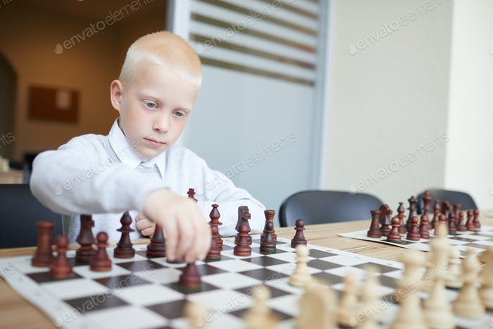 Boy making chess move