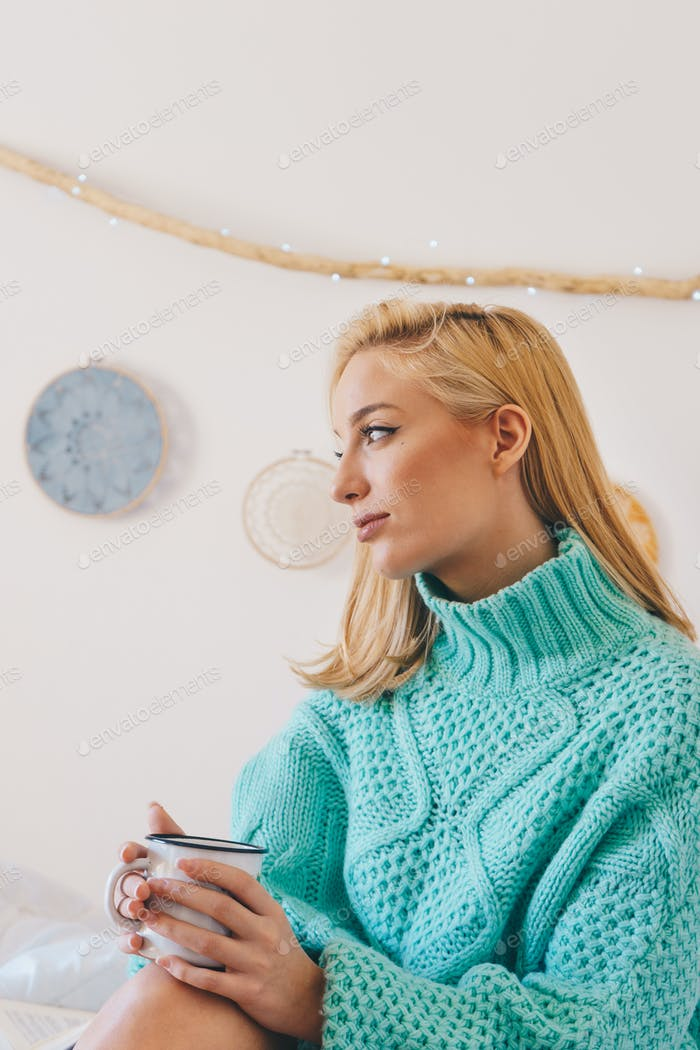 Beautiful young woman with a cup of coffee