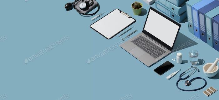 Doctor desktop with medical equipment