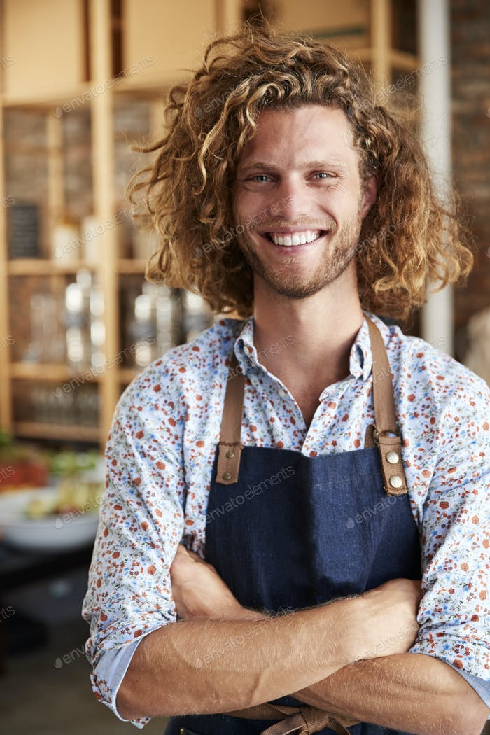 Portrait Of Male Owner Of Sustainable Plastic Free Grocery Store
