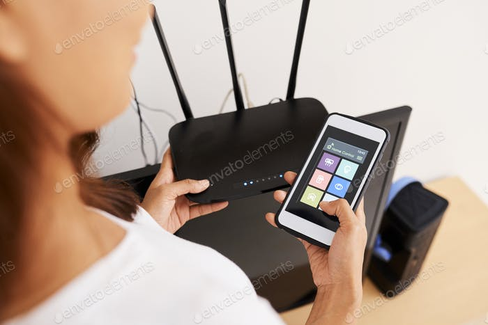 Woman Connecting to Wi-fi Router