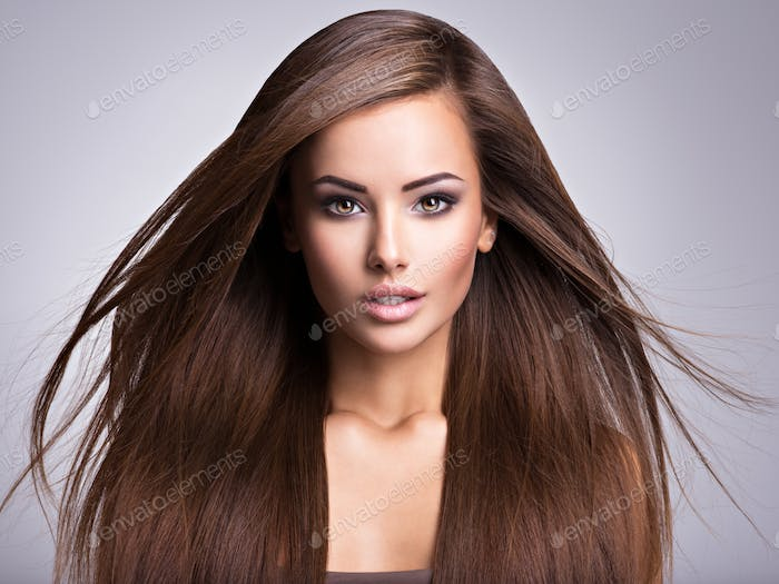 Portrait of Beautiful young woman with long straight brown hair.