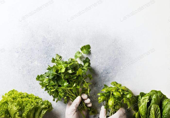 Concept of safe shopping at grocery stores during a pandemic. Fresh greens, salad vitamins