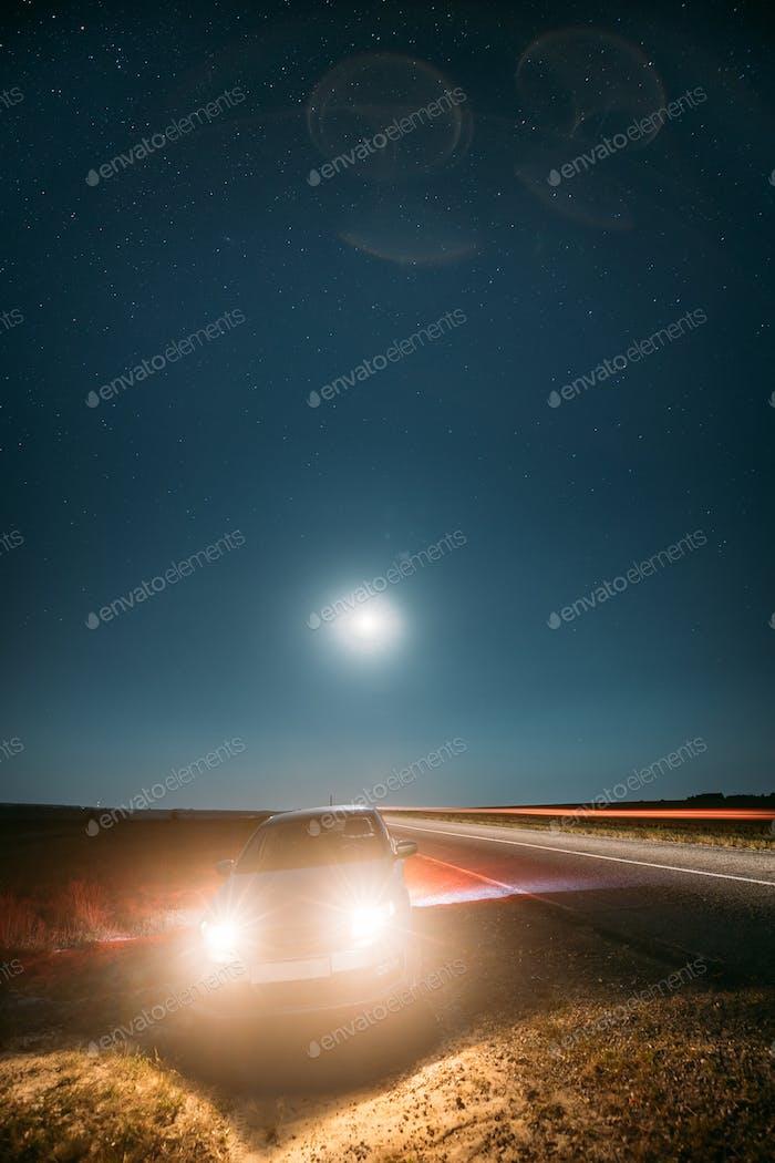 Night Starry Sky Above Country Asphalt Road In Countryside. Seda