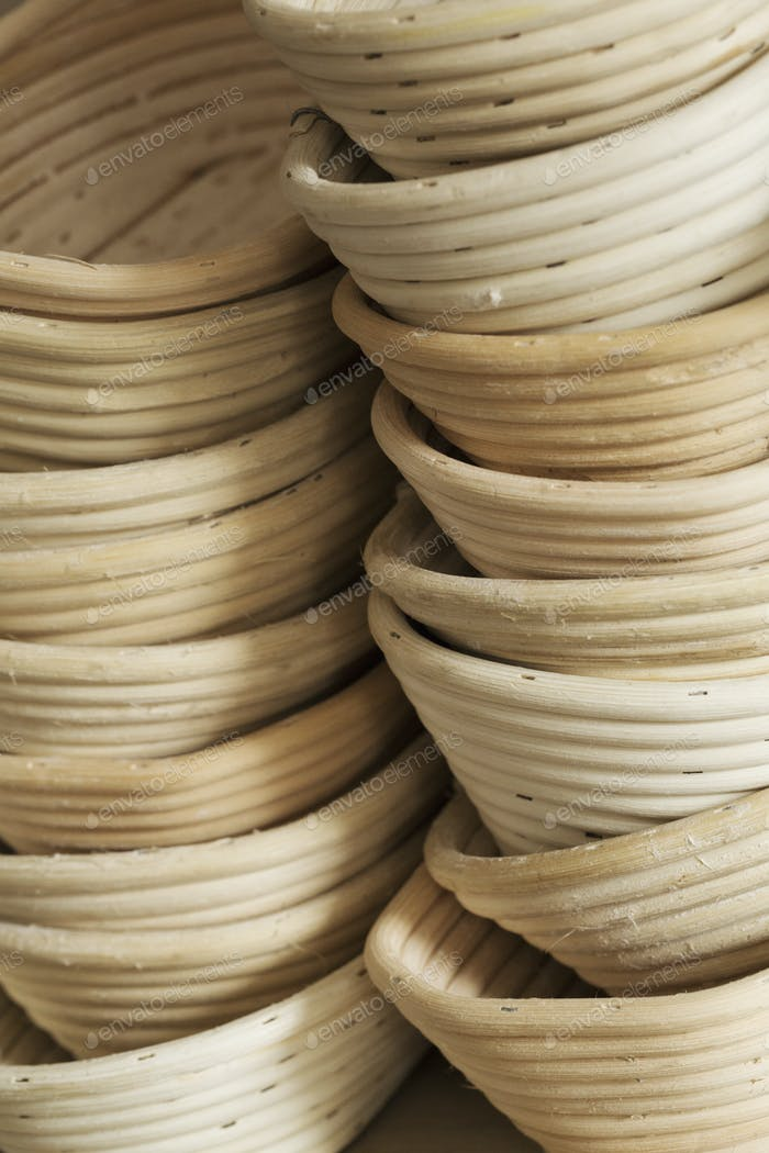 Close up of a stack of rattan proofing baskets.