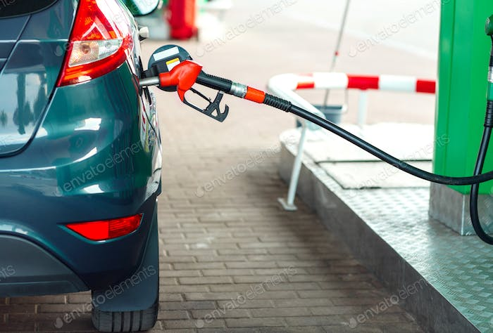 Car refueling on a petrol station close up