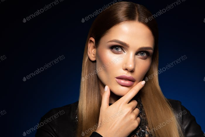 Beauty fashion portrait on blue wall background