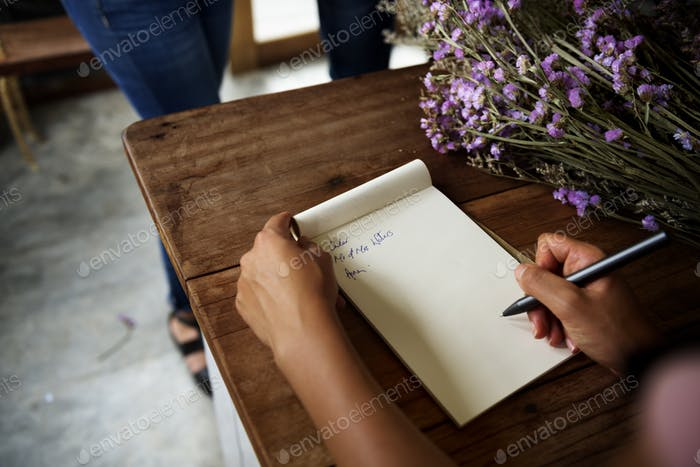 Woman hands is writing note of reminder
