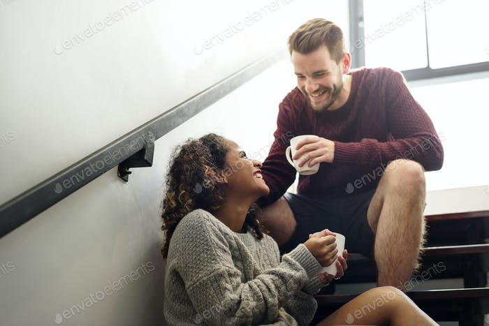Cheerful young couple is talking