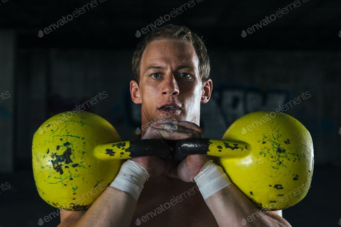 Man working out with dumbbells in hands