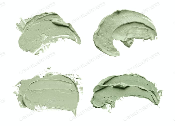Blue clay facial mask smear on white isolated background