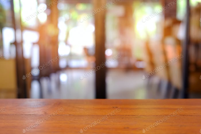 Wooden floor with blurred cafe background.
