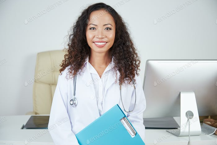 Female doctor at her office