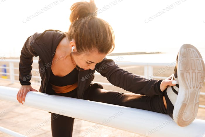 Sports woman make stretching exercises