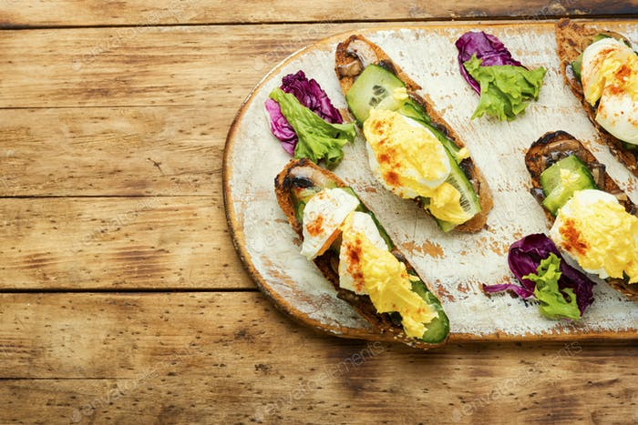 Bruschetta with eggs benedict