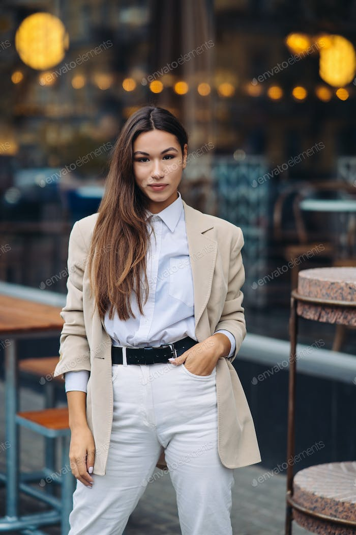Portrait of a young fashionable woman on the street