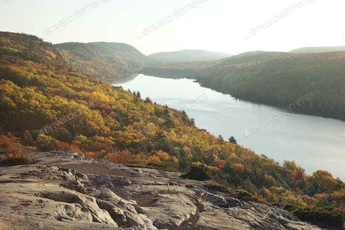 Lake of the Clouds in Michigan Surrounded by Hills and Trees in Fall Color