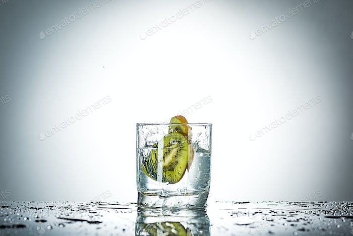 water splash in glass of gray color