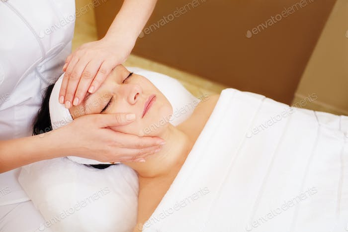 Facial treatment with professional massage of cosmetician