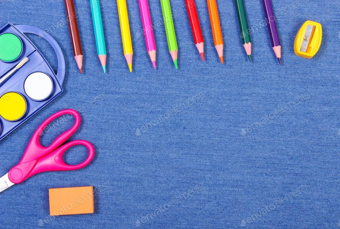 School and office supplies on jeans background, copy space for text