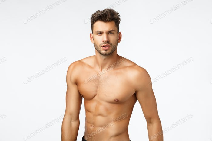 Waist-up shot naked handsome, sexy athlete, sportsman with bare torso, six-pack, perfect body