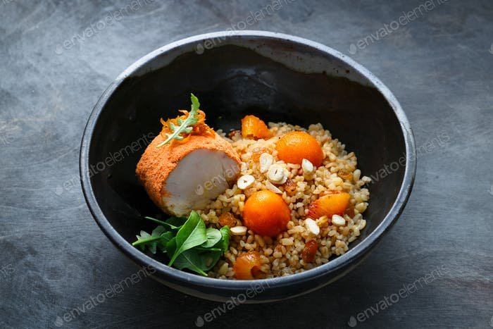 Baked turkey with bulgur, pumpkin, raisins and orange, copy space