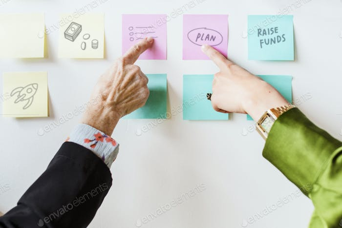 Creative people pointing to notepapers