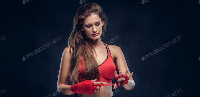 Portrait of beautiful woman in red sporty bra