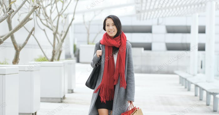 Woman go shopping with paper bag