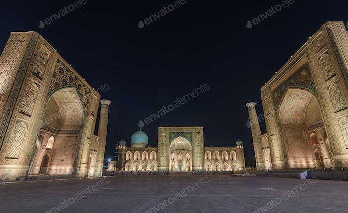 Registan Square at night, with imposing Madrasa buildings, Ulugh Beg Madrasah, Sher-Dor Madrasah and
