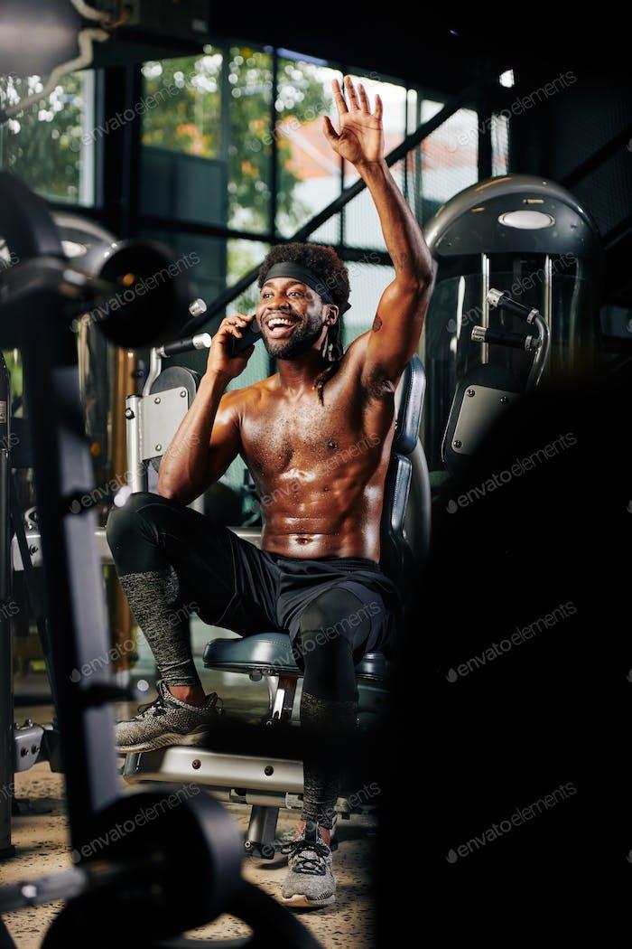 Man Greeting Someone In Gym
