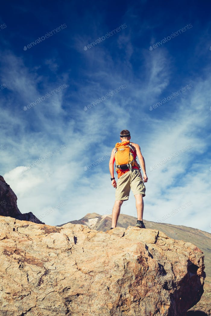 Man celebrating inspiring mountains view