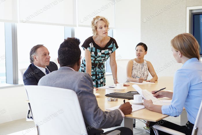 Five Businesspeople Having Meeting In Boardroom