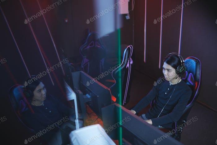 High Angle at Asian Man Playing Videogame
