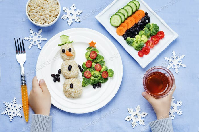 children's hands with Christmas lunch with healthy food