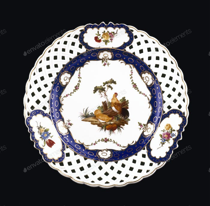 Antique plate on black background