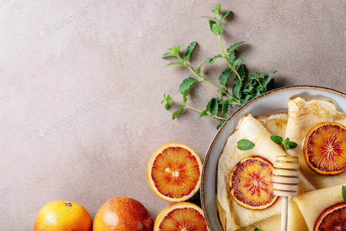 Homemade pancakes with blood oranges