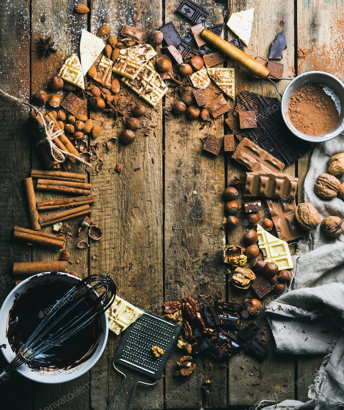 Hot chocolate cooking ingredients over rustic wooden background, copy space