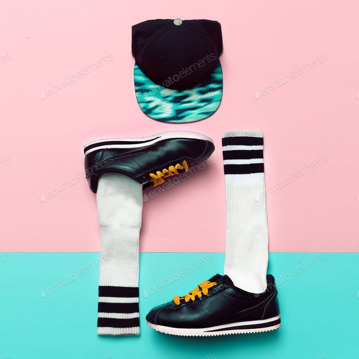 Minimal fashion creative art. Stylish sneakers and socks. Cap. S