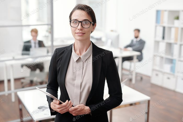Young Businesswoman Posing in Office
