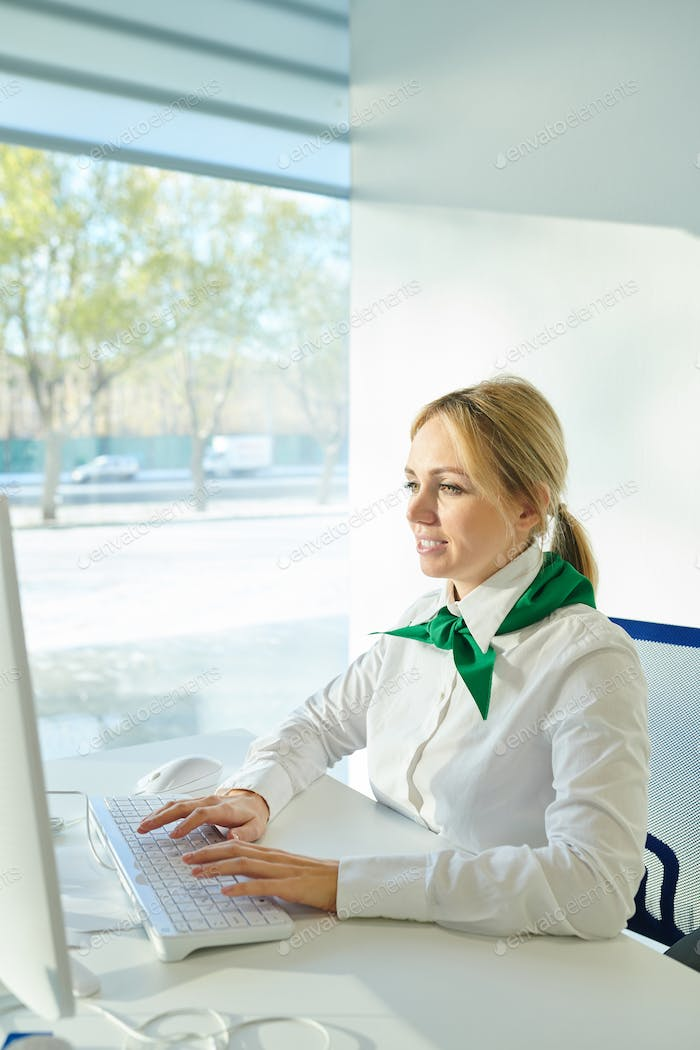 Busy lady in corporate outfit working with computer